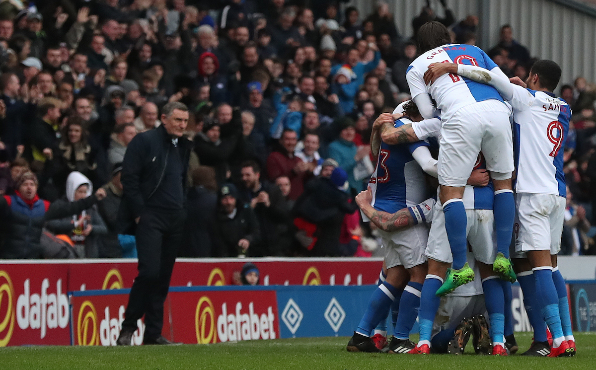 Rovers celebrate Charlie Mulgrew's opening goal in the win over Shrewsbury Town