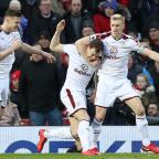 Lancashire Telegraph: Ashley Barnes celebrates his goal for Burnley at Old Trafford
