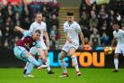Sam Vokes gets a shot away during Burnley's defeat to Swansea at the Liberty Stadium