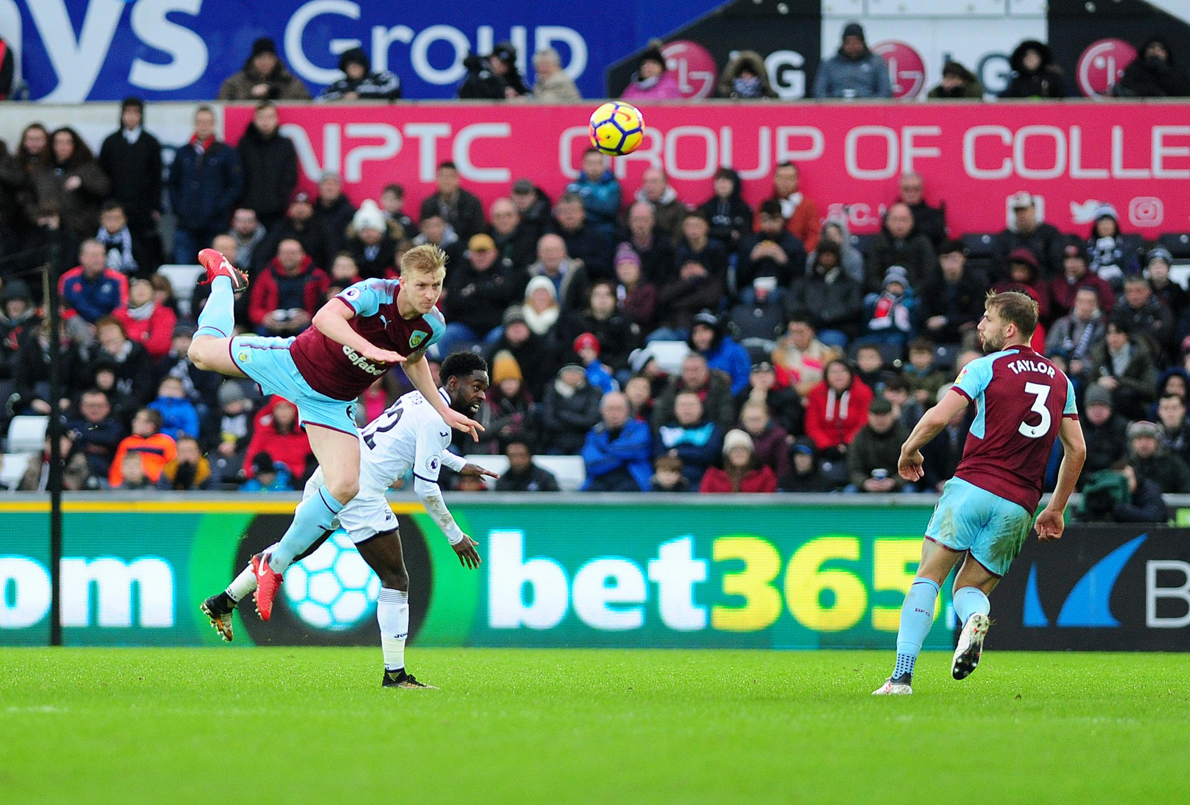 Ben Mee wins a header during the defeat to Swansea City