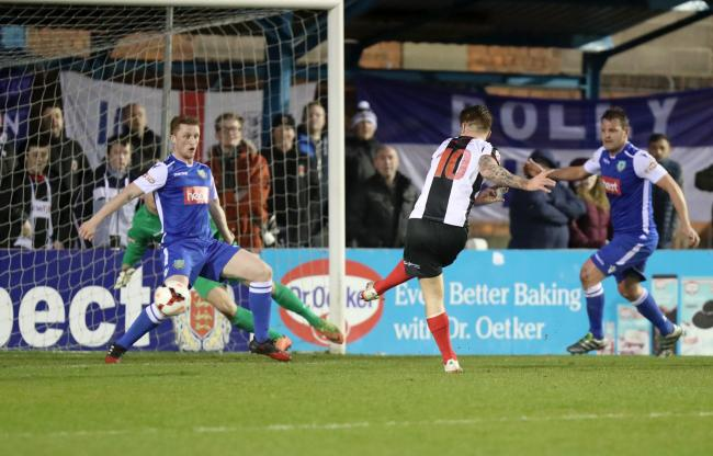 Jason Walker scores the winner for Chorley Picture: KIPAX