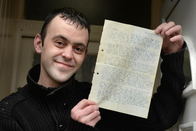 Paul McAuley pictured with a letter he found time capsule in the wall of his house  dating from 20 years ago