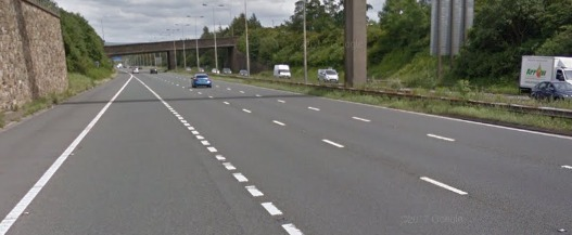 A car has struck the central reservation on the M65