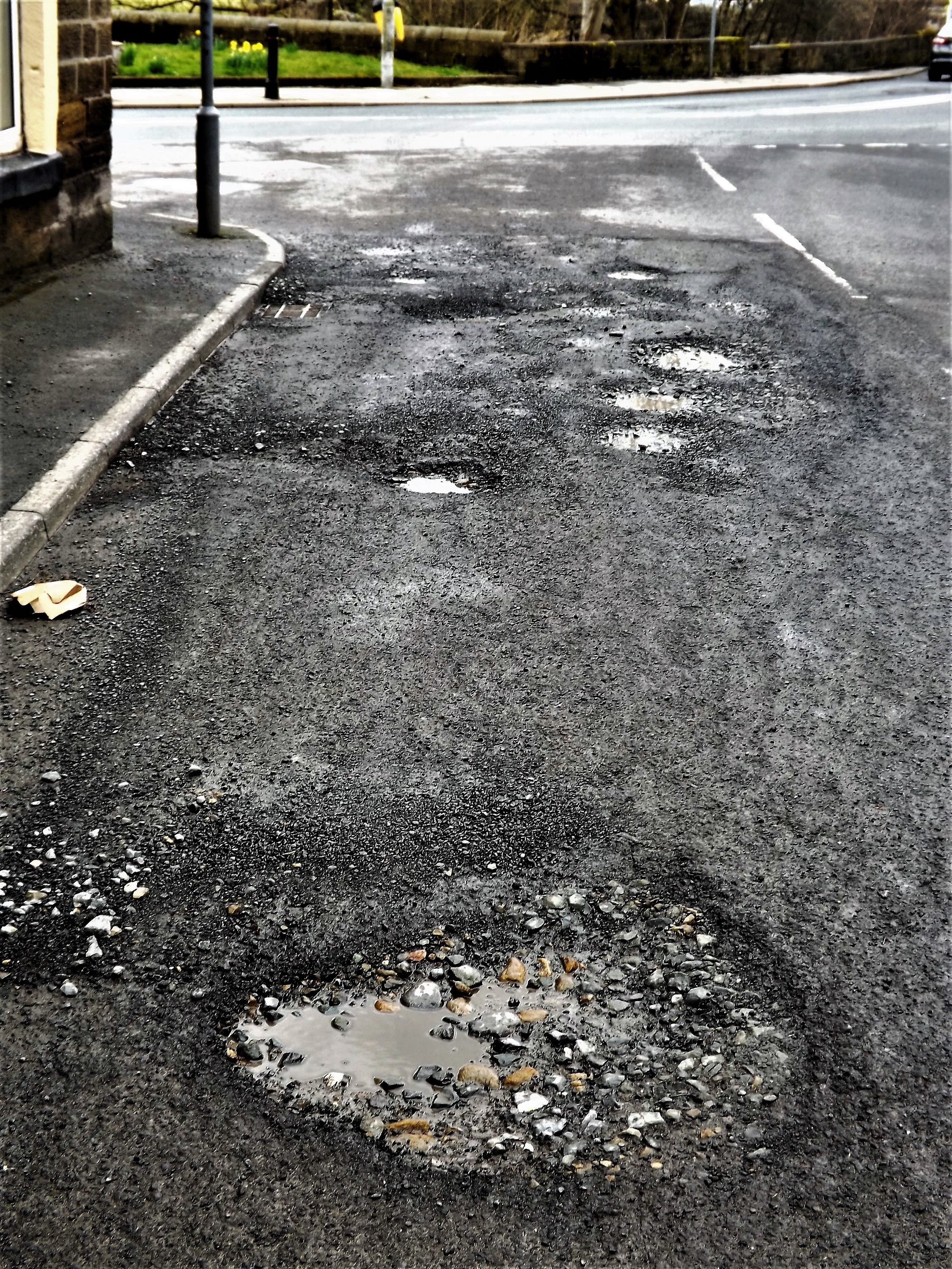 Potholes in Winewall village