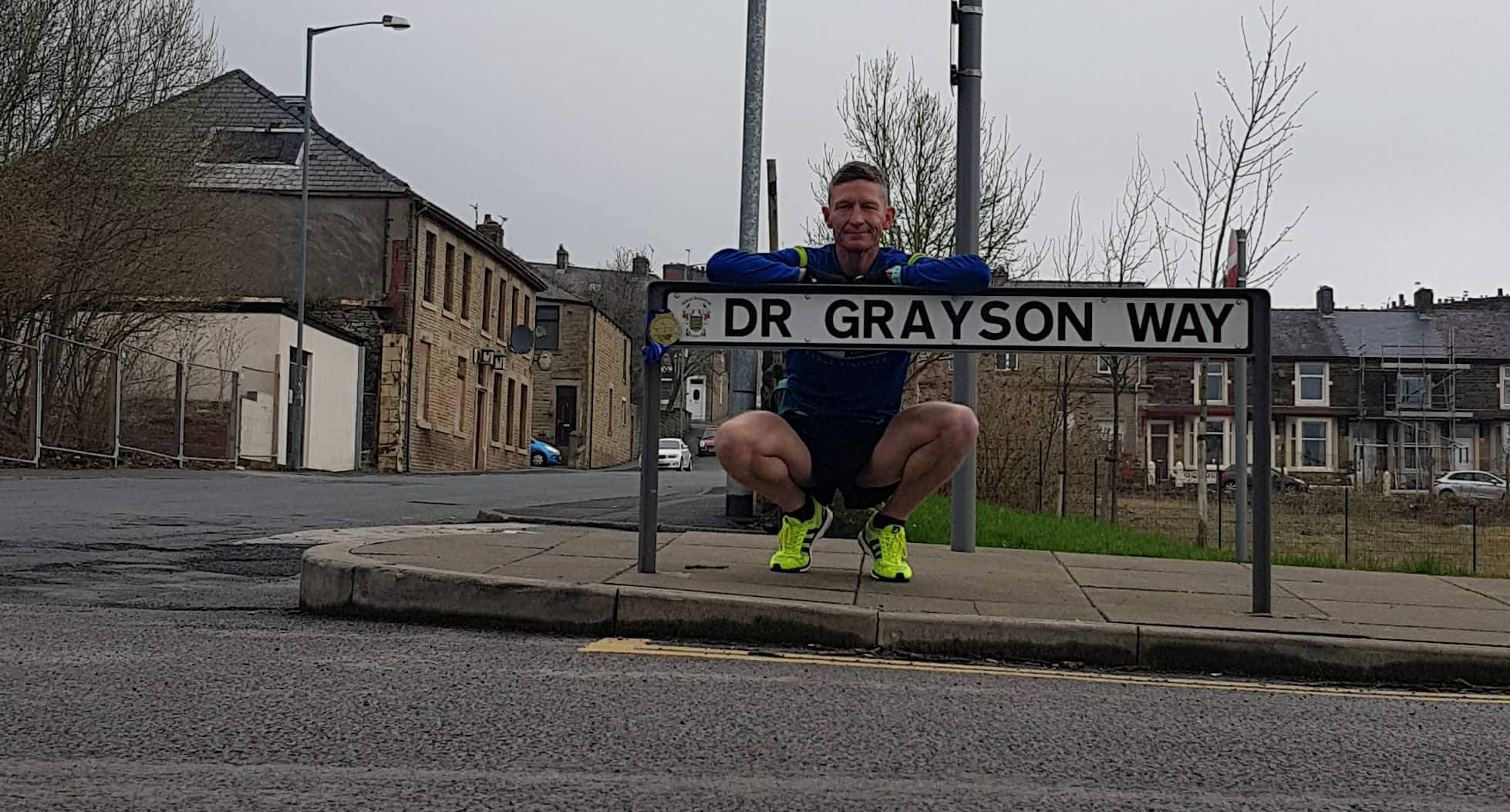 Críostóir Grayson with the medal left on the sign in memory of his brother Dr Robert Grayson