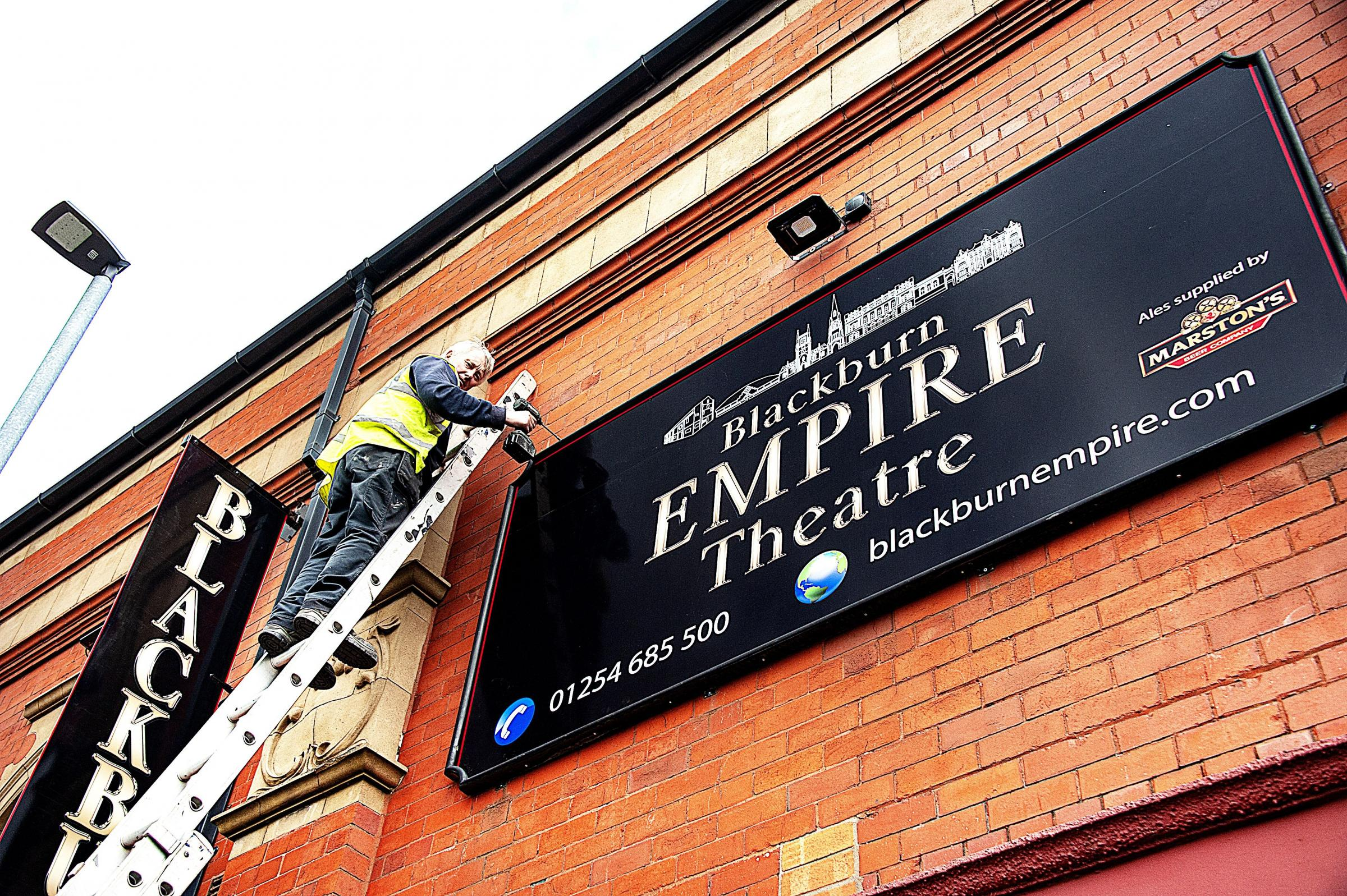 The new signs go up at the Blackburn Empire (Picture: Mikeseye Photographic)