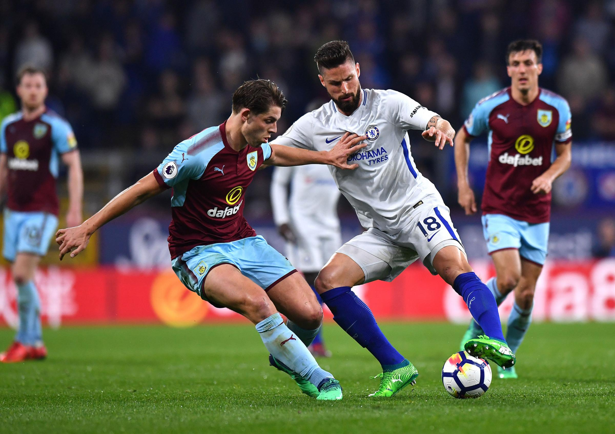 James Tarkowski tries to fend off Olivier Giroud during Burnley's defeat to Chelsea