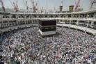 Muslim pilgrims circle the Kaaba, the cubic building at the Grand Mosque in Mecca