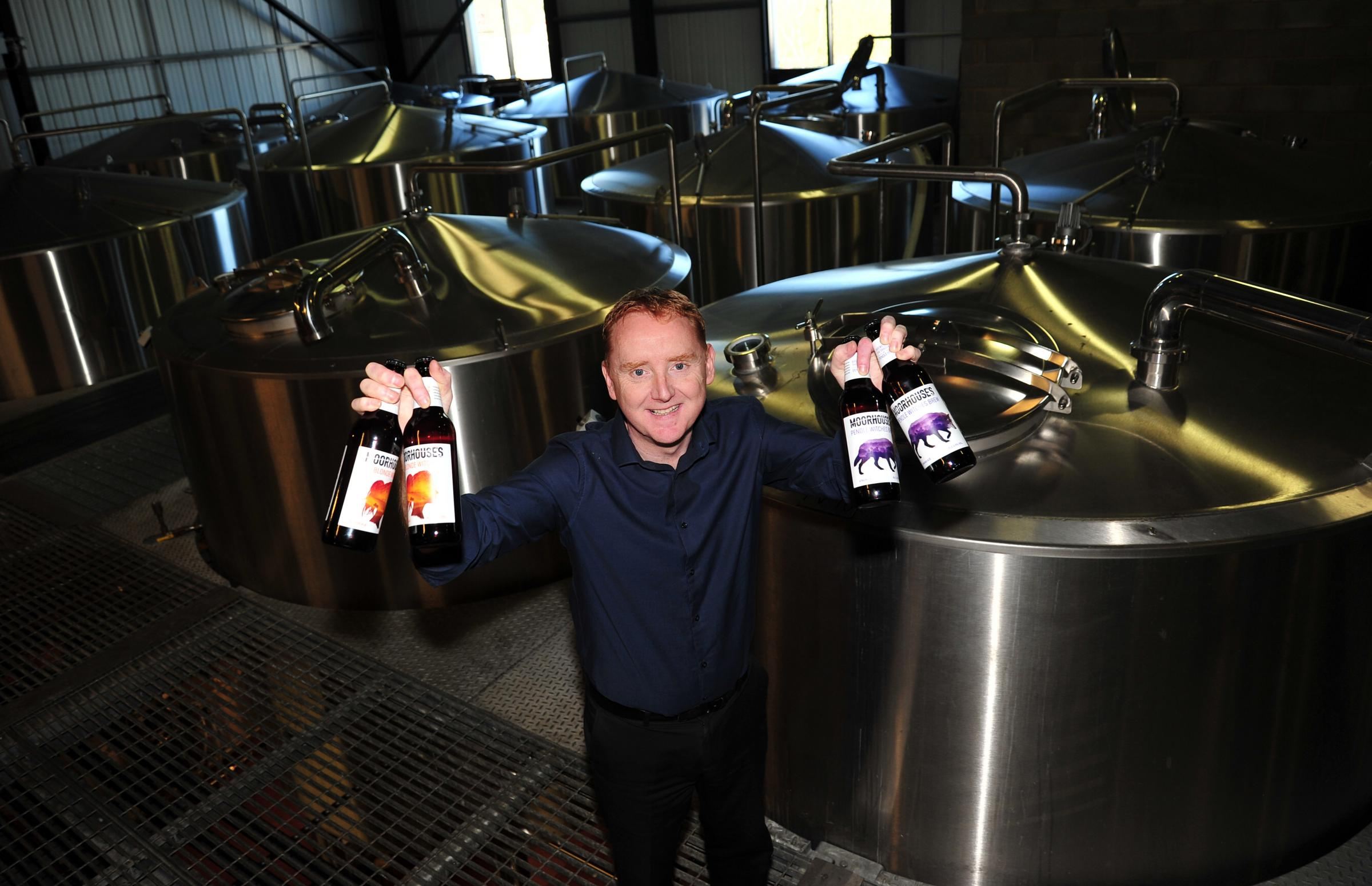 Managing Director of Moorhouse Brewery, Lee Williams with the new ales and branding at the brewery in Burnley