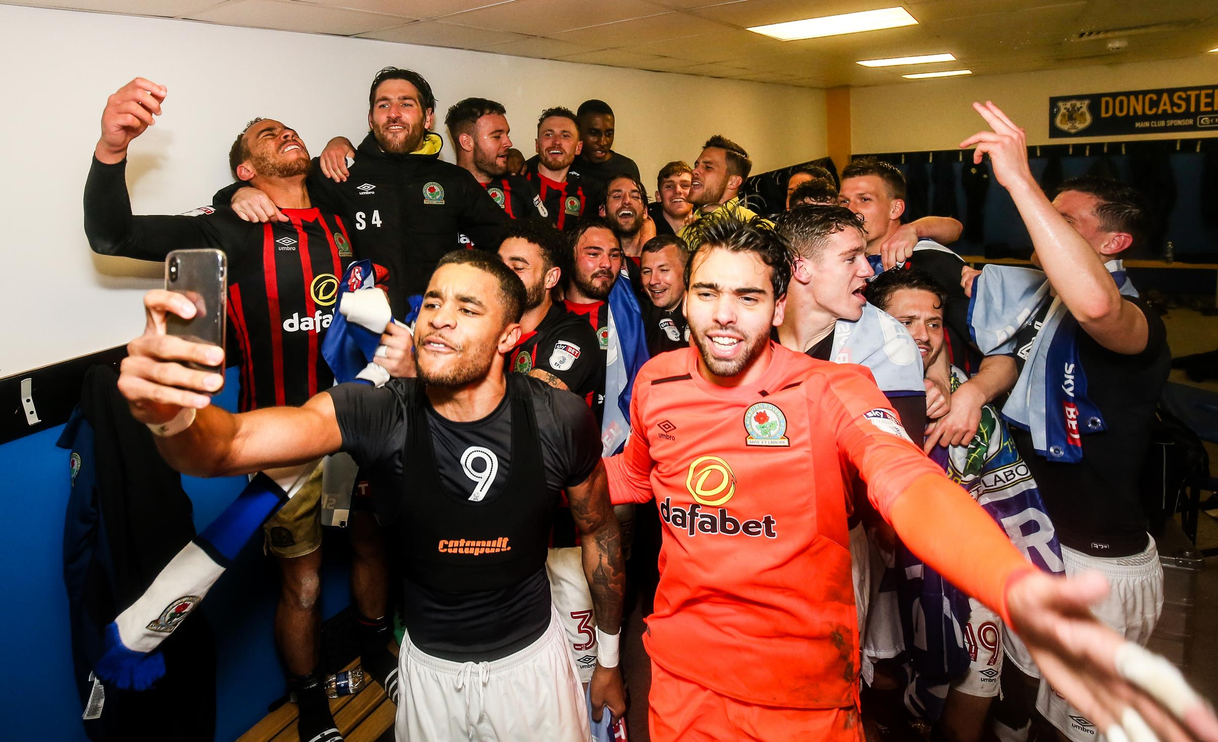 Blackburn Rovers' players celebrate promotion to the Championship..Photographer Andrew Kearns/CameraSport..The EFL Sky Bet League One - Doncaster Rovers v Blackburn Rovers - Tuesday 24th April 2018 - Keepmoat Stadium - Doncaster..World Copyright ©