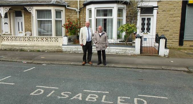Cllrs Roy Davies (left) and Paul Browne in a disabled bay in  London Terrace, Darwen