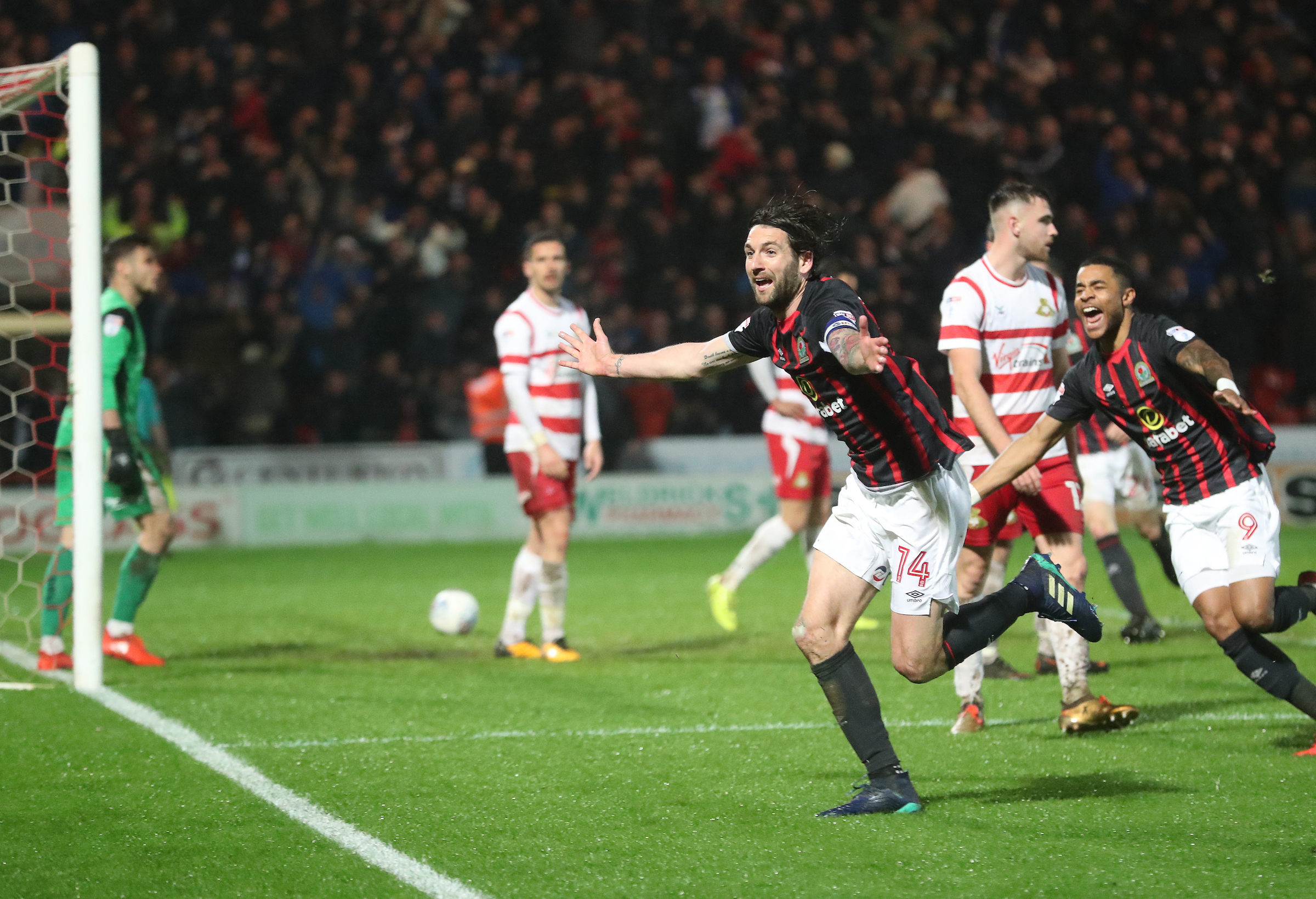Charlie Mulgrew headed in Rovers' winner at Doncaster to seal promotion