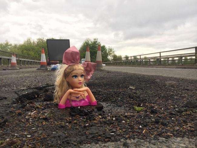 Creepy doll heads and penis graffiti: The weird ways people deal with potholes