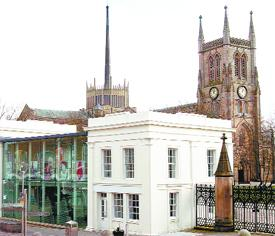 TRANSFORMED: Blackburn's historic Cathedral and, in the foreground, the sensitvely restored Waterloo Pavilions in the centre of the town