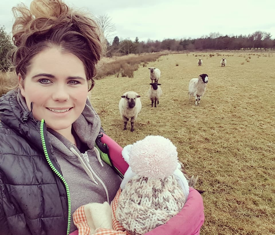 Georgie Mitchell with some of her sheep and her new 'baby' Peggy