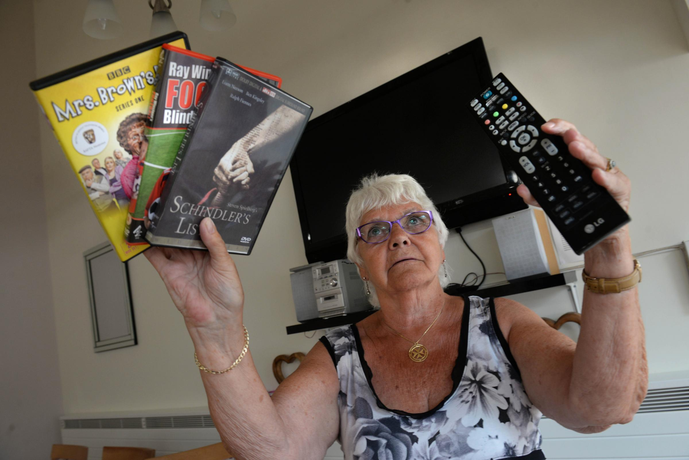 Showley Court, Salesbury residents not at all happy as they unable to play dvd's pictured here is resident June Mercer with a blank screen.