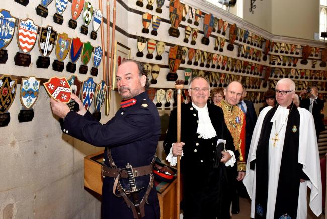 Tony Attard hanging his shield at Lancaster Castle watched by David Cam, his Under-Sheriff and The Rev Christopher Newlands his chaplain. Picture by Peter Defty