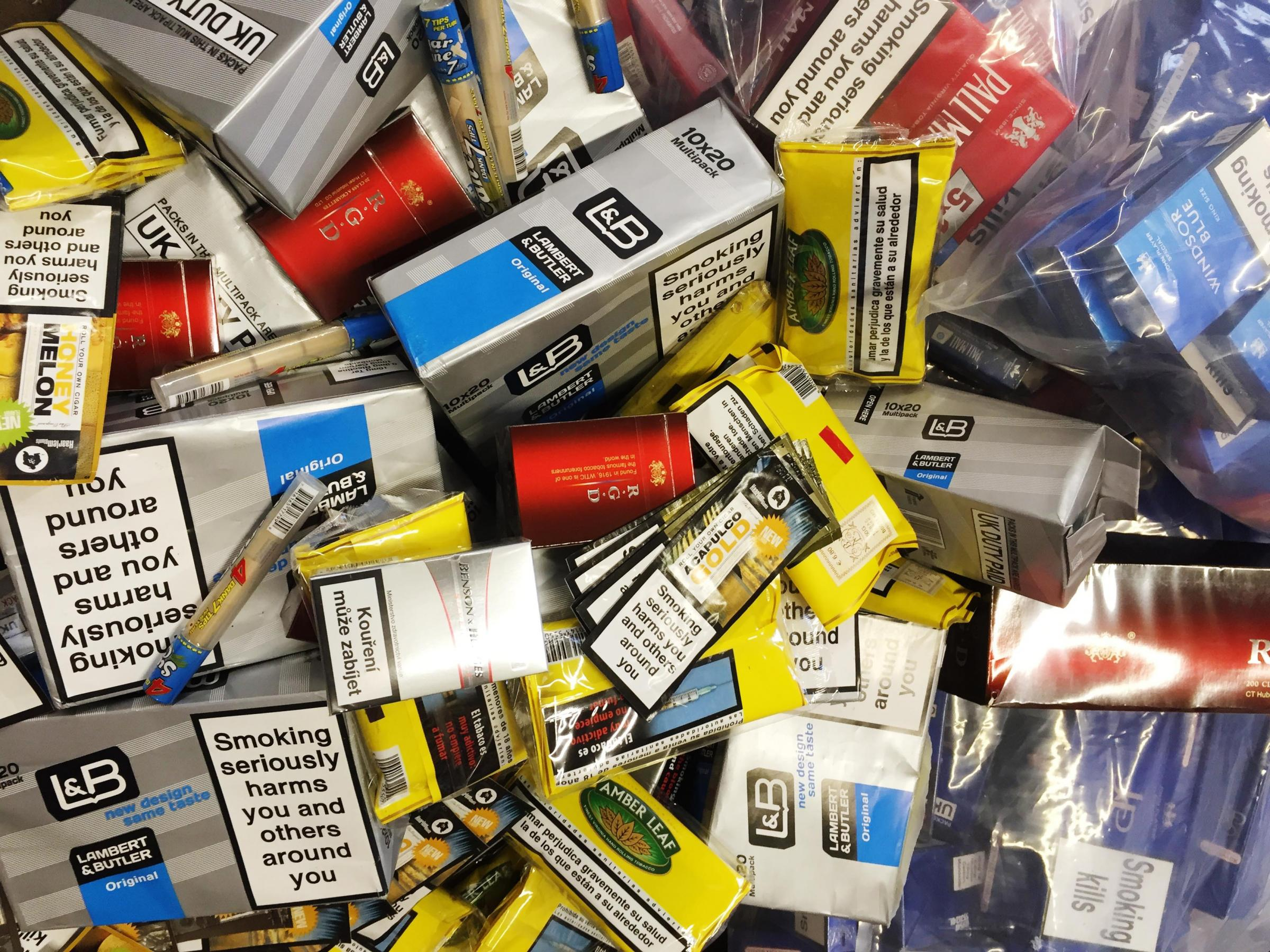 Lancashire Trading Standards and police seized several thousand pounds of illicit cigarettes during raid in Nelson