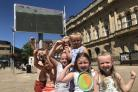 Youngsters enjoying the England match outside Blackburn town hall