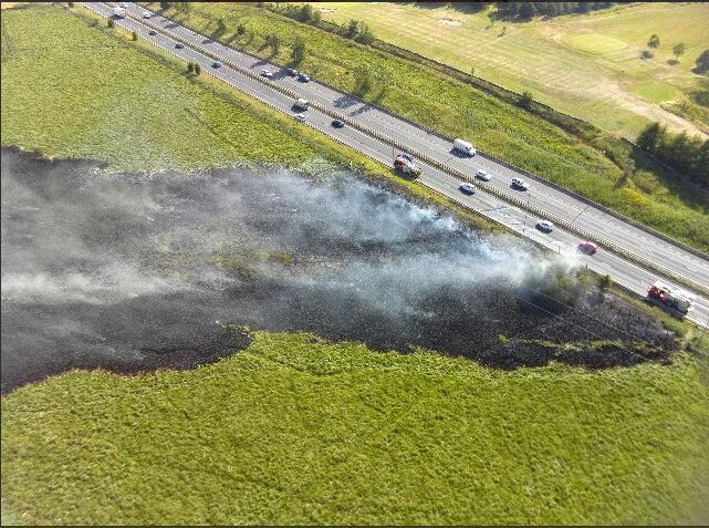 A Lancashire Fire and Rescue Service done picture of the grass next to the A56 near Rising Bridge