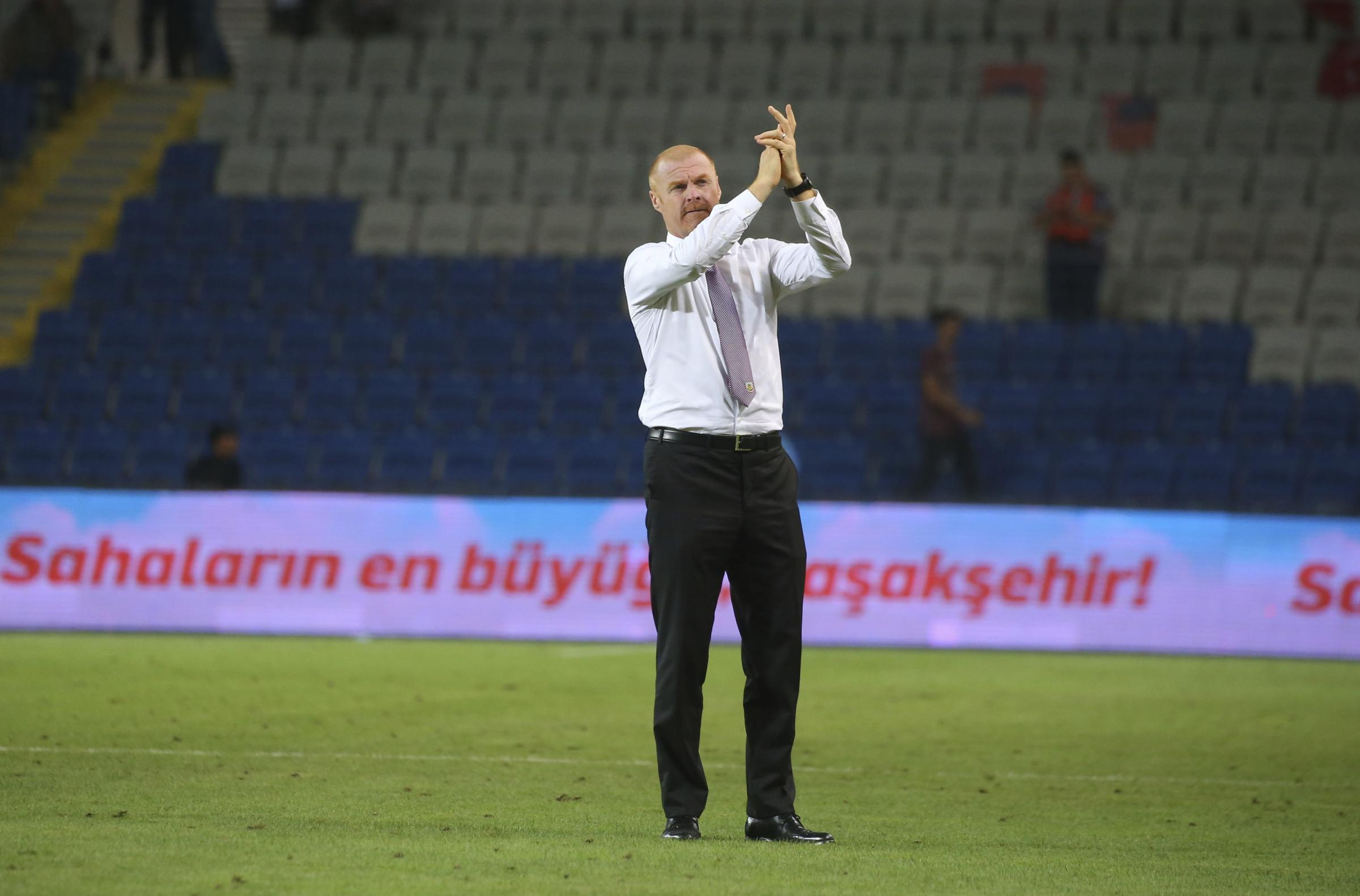 Burnley's head coach Sean Dyche, applauds his team's fans following the Europa League qualification soccer match between Istanbul Basaksehir and Burnley, at the Fatih Terim stadium in Istanbul, Thursday, Aug. 9, 2018. The match ended 0-0 draw. (AP