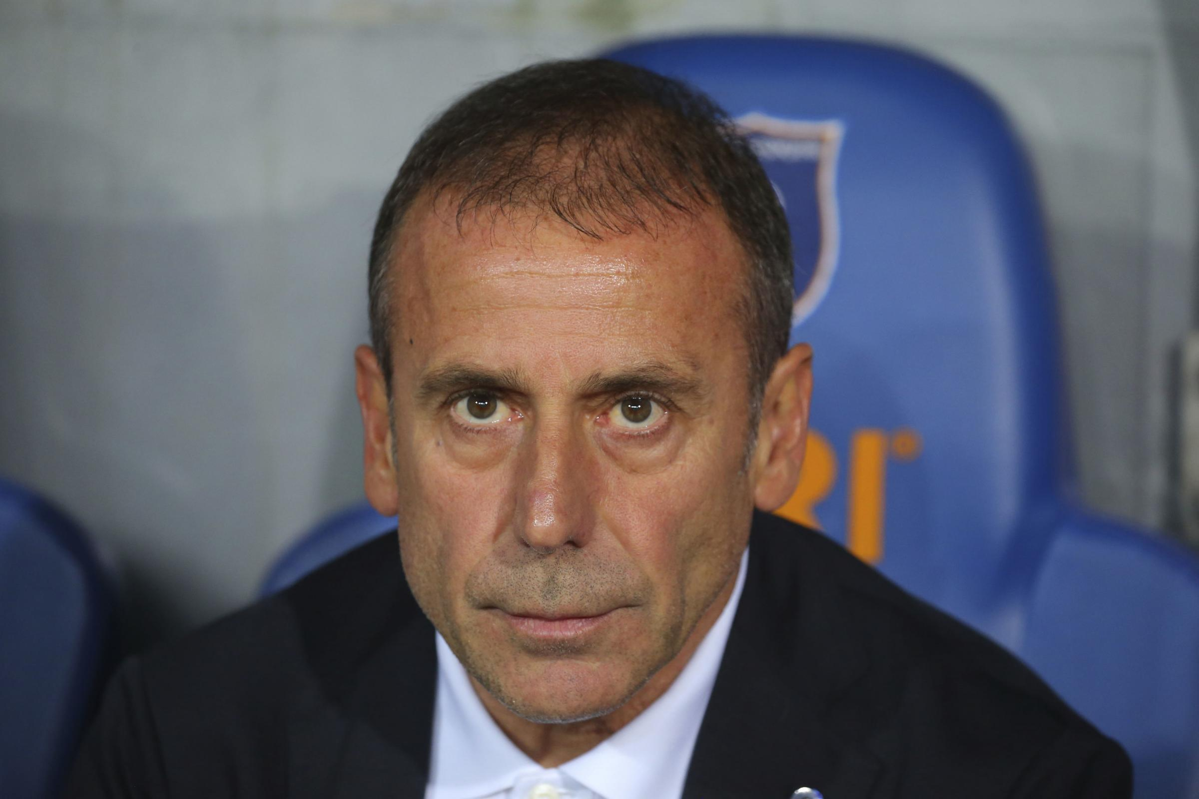 Istanbul Basaksehir's hed coach Abdullah Avci sits on the bench prior to a Europa League qualification soccer match between Istanbul Basaksehir and Burnley, at the Fatih Terim stadium in Istanbul, Thursday, Aug. 9, 2018. (AP Photo).