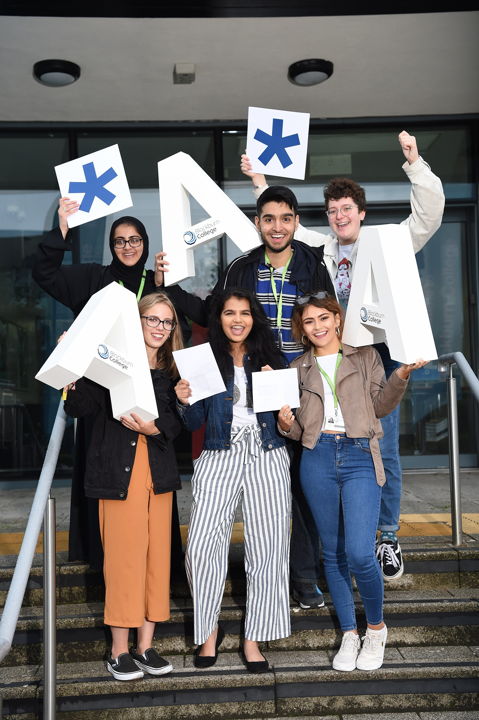 Students celebrating their results at Blackburn College