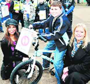 SIGN: Actress Shobna Gulati presents Cameron Holt with his prize bike, with Twin Valley Homes' Janet Fishwick