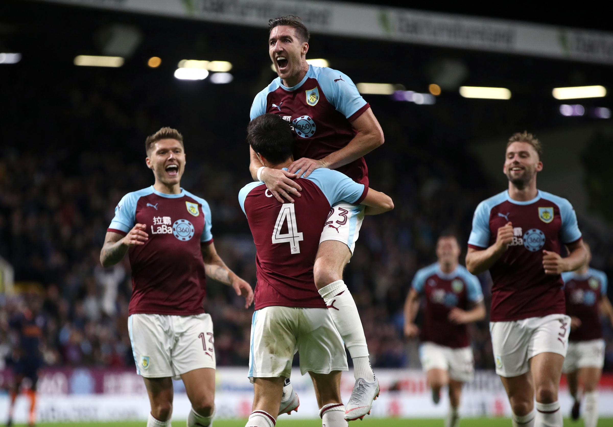 Burnley's Jack Cork celebrates scoring his side's first goal of the game with Stephen Ward (top) during the UEFA Europa League, Third Qualifying Round match at Turf Moor, Burnley. PRESS ASSOCIATION Photo. Picture date: Thursday Augus