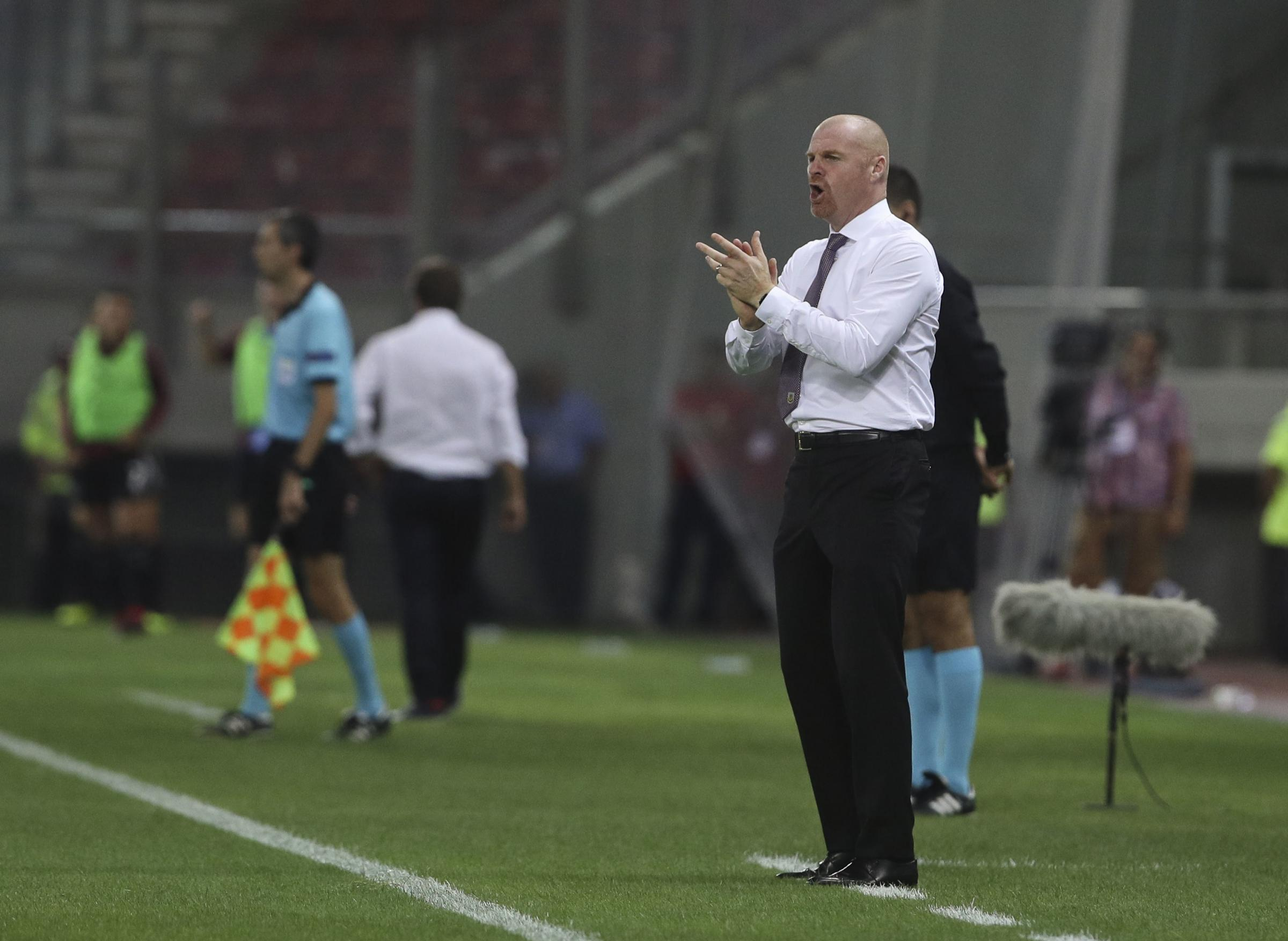 Burnley's coach Sean Dyche shouts during the Europa League playoffs, first leg, soccer match between Olympiacos Piraeus and Burnley at the Karaiskakis Stadium, in Athens, Greece, Thursday, Aug. 23, 2018.(AP Photo/Petros Giannakouris).