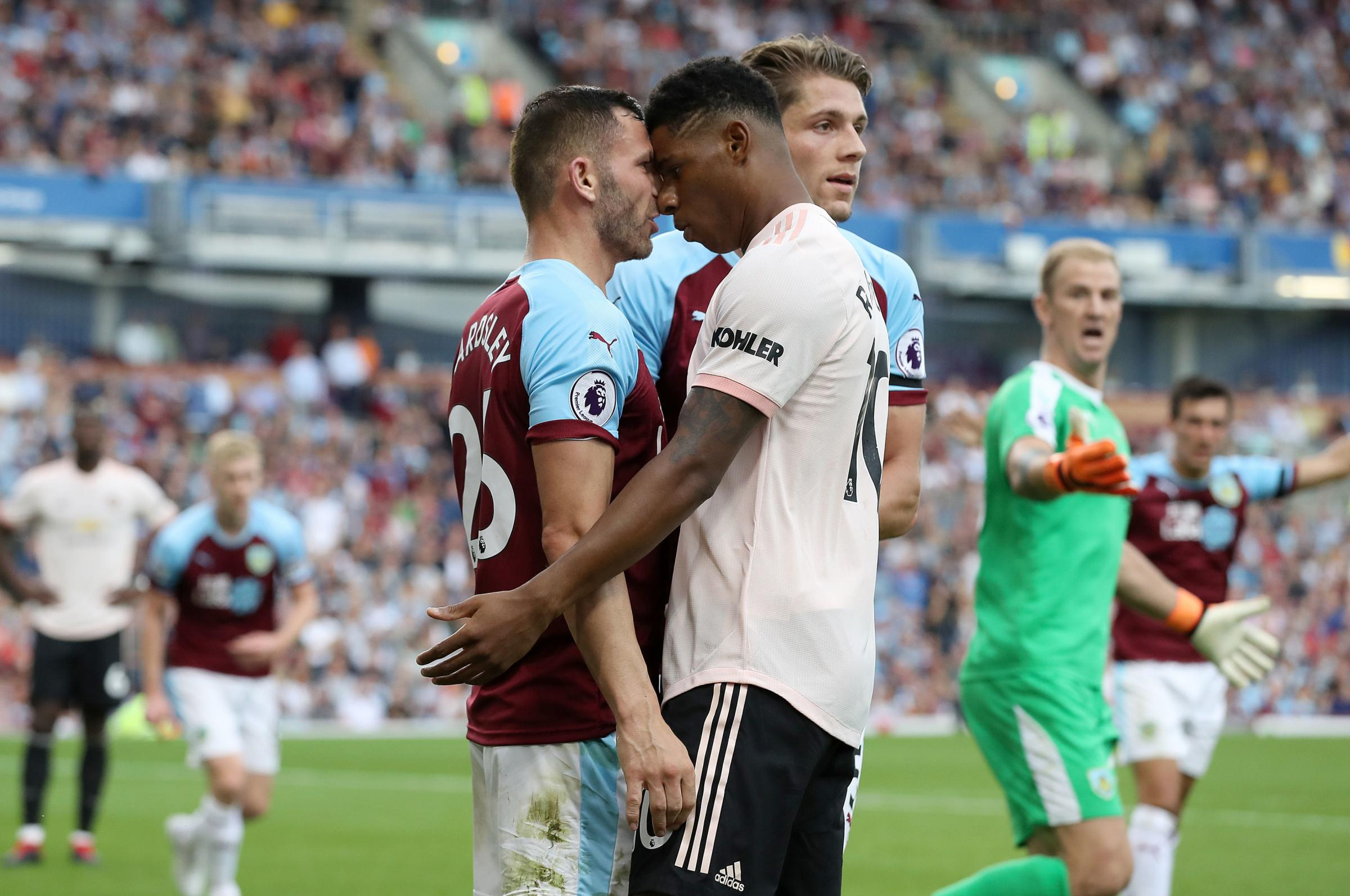Phil Bardsley and Marcus Rashford clash in the incident which saw Rashford sent-off