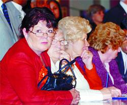UNCERTAIN FUTURE: Council leader Kate Hollern (left) watches anxiously at the count at Blackburn Town Hall last night