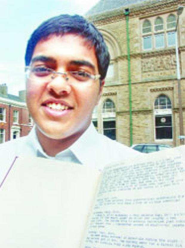 PAST UNCOVERED: Hassan Adam with the unknown soldier's diary