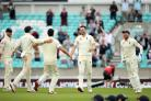 England's James Anderson celebrates taking the last wicket during the victory over India