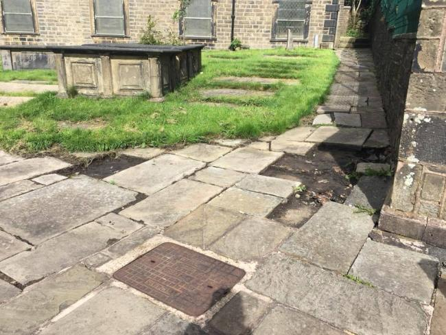 Concern over the paving stones theft at St James Church in Haslingden