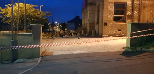 Police partially close two roads following a building collapse