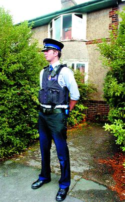 GUARD: A policeman outside the house in Trent Road, Nelson, where a man was arrested