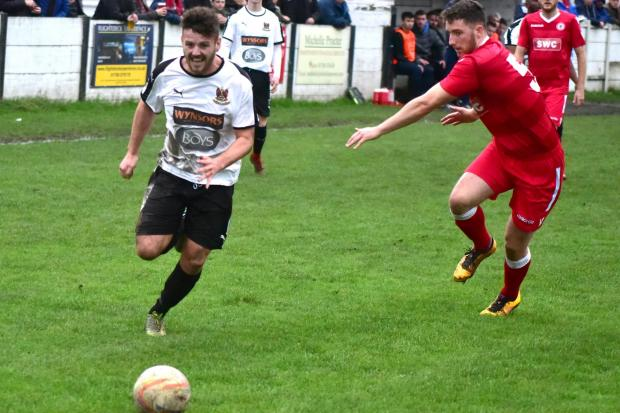 Action from Bacup Borough's (white) defeat to Longridge Town at the weekend