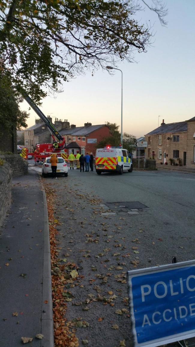 Fire service dealing with house fire on Bury Road, Edenfield