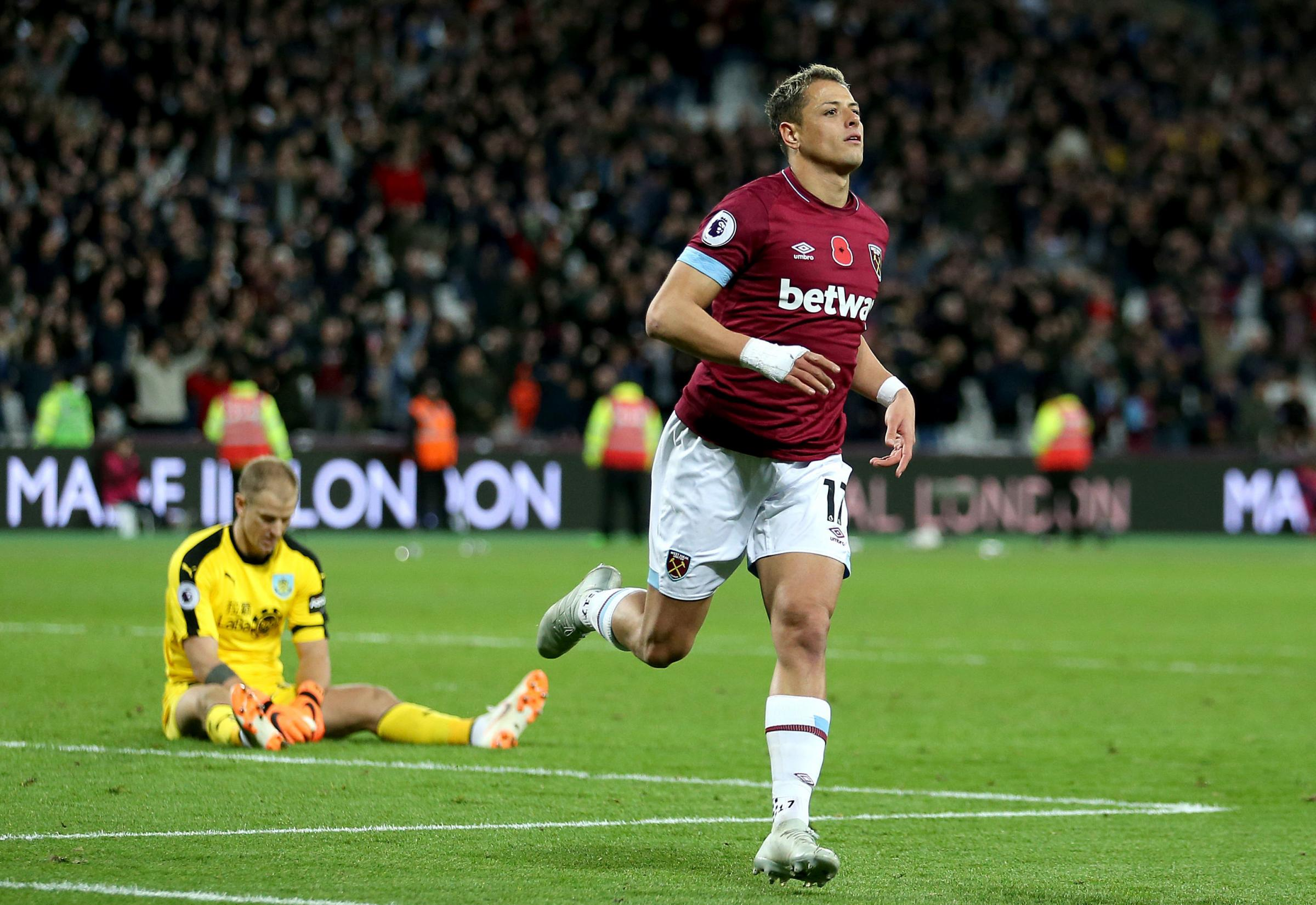Joe Hart looks crestfallen as Javier Hernandez celebrates West Ham's fourth goal
