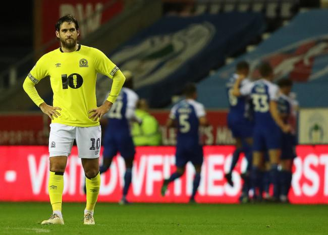 Danny Graham watches on as Wigan celebrate their opening goal