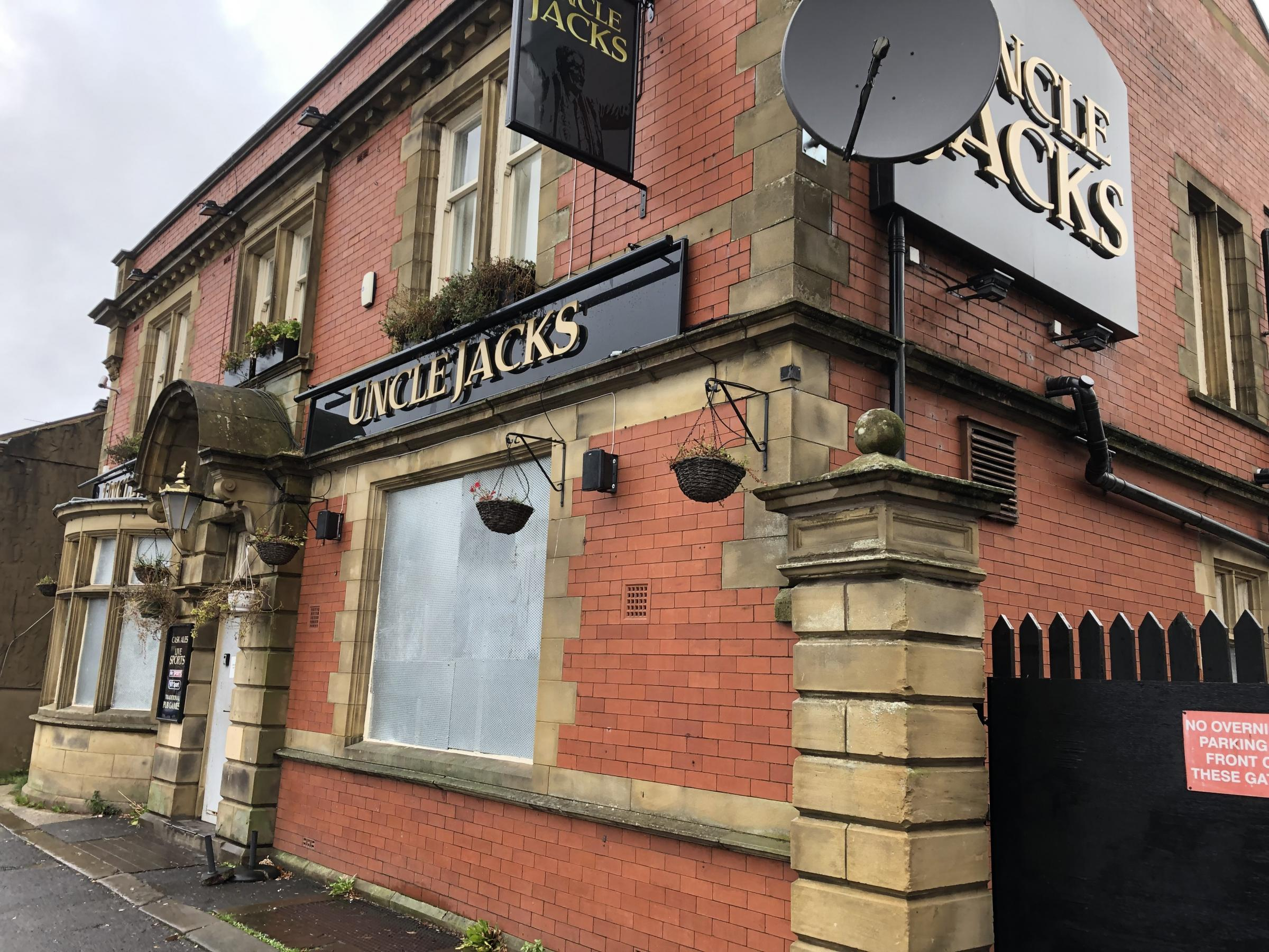 Uncle Jacks pub which is boarded up in Lower Darwen