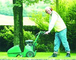 Lancashire Telegraph: MUCKING IN: George Graham, gets back to grass roots with a lawn mower