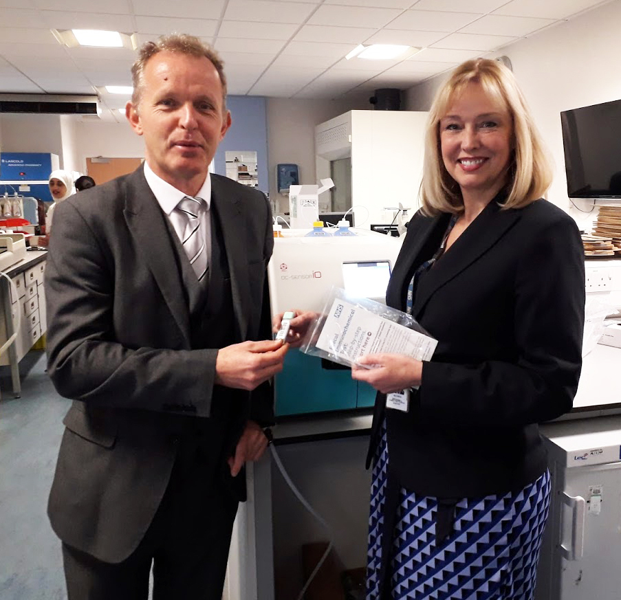 Dr Neil Smith, GP at Oakenhurst Medical Centre and Dr Kathryn Brownbill (ELHT clinical director for Biomedical Science) with the new bowel cancer testing kit and equipment