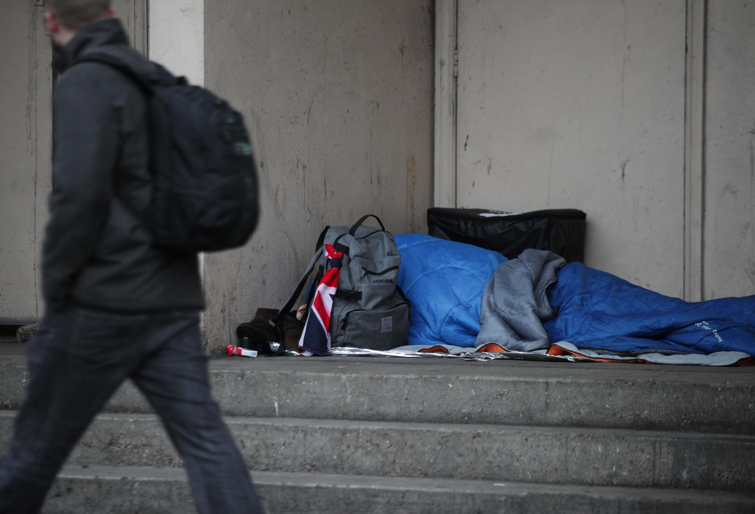 "Embargoed to 0001 Wednesday December 05.File photo dated 07/02/17 of a person sleeping rough in a doorway. Shelter has warned the UK's housing crisis will be ""felt across a generation"" as the latest figures reveal the scale of children livin"