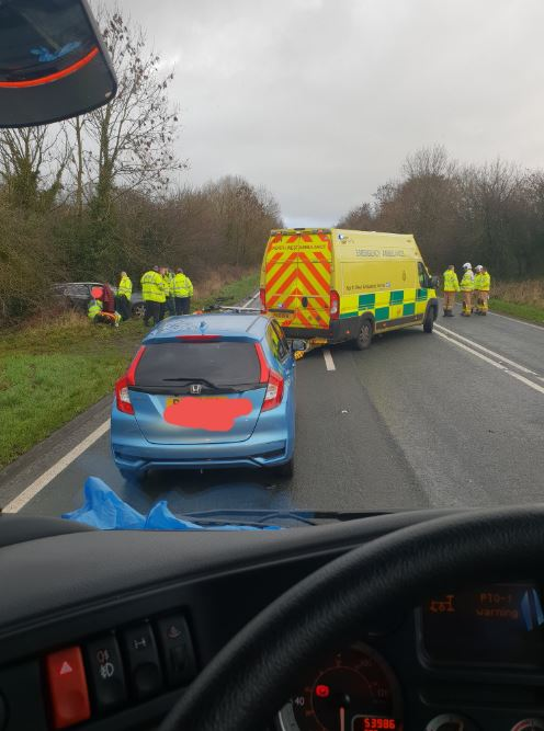Road CLOSED and emergency services at scene of crash