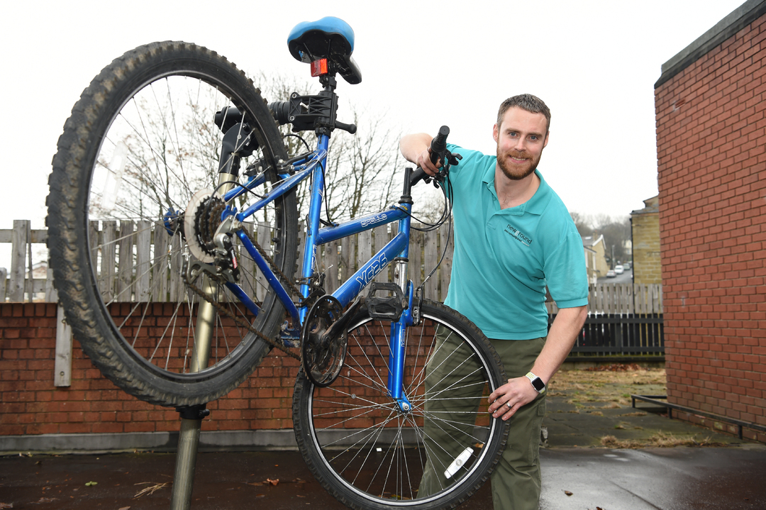 Newground's James Kenyon with an upcycled cycle