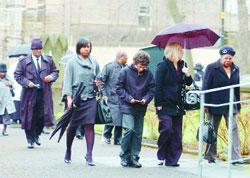 Mourners gather to pay their respects