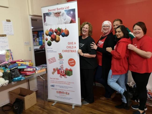 Slimming World members from groups in Blackburn, Darwen and Rishton donate toys and gifts to children's charity, Secret Santa
