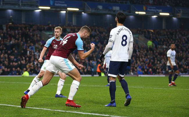 Burnley's Ben Gibson (centre) celebrates scoring his side's first goal of the game during the Premier League match at Turf Moor, Burnley. PRESS ASSOCIATION Photo. Picture date: Wednesday December 26, 2018. See PA story SOCCER Burnley. Photo credit